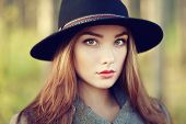 stock photo of coat  - Portrait of young beautiful woman in autumn coat - JPG