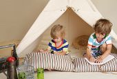 picture of teepee tent  - Child preschooler kids playing at home indoors with a teepee tent