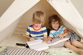 stock photo of teepee tent  - Child playing at home indoors with a teepee tent - JPG