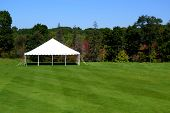 stock photo of tent  - a white events tent on a plush green lawn - JPG