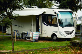 stock photo of caravan  - Caravan with a awning at a camp site - JPG