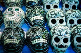 pic of stall  - Traditional mexican day of the dead souvenir ceramic skulls at market stall - JPG
