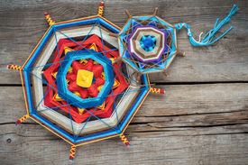 pic of tantra  - Two knitted tibetan mandala from threads top view - JPG