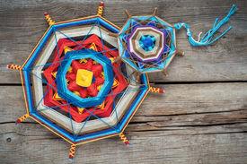 stock photo of tibetan  - Two knitted tibetan mandala from threads top view - JPG