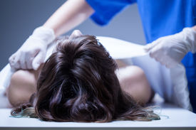 pic of autopsy  - View of nurse covering the dead body - JPG