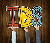 picture of colitis  - Group of Hands Holding IBS Letter - JPG