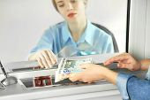 image of cashiers  - Teller window with working cashier  - JPG