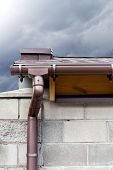 foto of downspouts  - Rain gutter system and downspout on roof of home