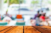 stock photo of tables  - Empty wood table and Coffee shop blur background with bokeh image - JPG