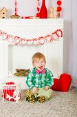 picture of naked children  - Child bow tie sitting near the fireplace at home - JPG