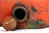 picture of manhole  - opened rusty manhole on the red fuel tank - JPG
