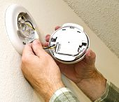 stock photo of smoke detector  - Close up of a smoke detector having the battery replaced - JPG
