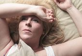 picture of whore  - A woman feel sick lying down on bed - JPG