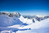 picture of caucus  - Russian winter landscape of Caucasus mountains during daytime in Sochi ski resort Krasnaya polyana - JPG