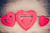 image of heartfelt  - Three red heart on wooden is beautiful - JPG