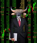 foto of bull head  - business man with bull head in tock investment concept - JPG
