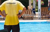 picture of save water  - Lifeguard keeping watch at pool - JPG