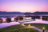 stock photo of raft  - Sunset at Lakeside raft house at Srinagarind Dam known as Thailand Maldives - JPG