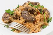 pic of liver fry  - lightly fried lambs liver chunks baked on top of a pilaf of rice - JPG
