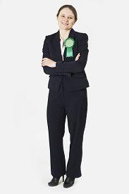stock photo of politician  - Full Length Portrait Of Female Politician Wearing Green Rosette - JPG