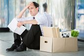 pic of angry man  - Fired frustrated man in suit sitting near office - JPG