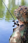 picture of catch fish  - Professional Fisherman with spinning catching predatory fish in the lake - JPG