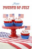 pic of united we stand  - Happy Fourth of July Cupcakes on red stand with USA flags on white wood shabby chice table - JPG