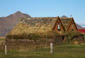 image of iceland farm  - Exterior of Old Farm Buildings with Grass Growing on Roof Tops at Moorudalur Highlands Settlement Eastern Iceland - JPG