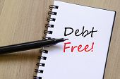 image of debt free  - White notepad and ink pen on the wooden desk Debt free concept - JPG