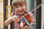 stock photo of violin  - Young Girl At School Learning To Play Violin - JPG