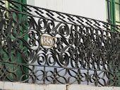stock photo of wrought iron  - Wrought iron balcony railing with 1857 date - JPG