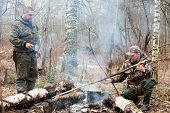 pic of hunter  - two hunters cooking dinner over a campfire - JPG