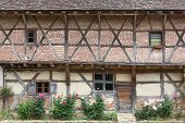 pic of farm-house  - Typical Bresse farm house in the department of Ain, France ** Note: Visible grain at 100%, best at smaller sizes - JPG
