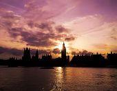stock photo of big-ben  - Sunset behind Big Ben over the river Thames - JPG