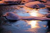 stock photo of tree snake  - Almost completely frozen scenic small river captured on a very cold evening in Helsinki - JPG