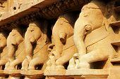 stock photo of khajuraho  - View of resting stone elephants at Lakshman Temple under Western Group of Temples at Khajuraho Madhya Pradesh India Asia  - JPG