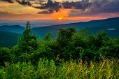 stock photo of virginia  - Sunset over the Blue Ridge Mountains seen from Skyline Drive in Shenandoah National Park Virginia - JPG