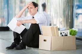 image of unemployed people  - Fired frustrated man in suit sitting near office - JPG