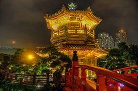 stock photo of hong kong bridge  - The Golden pavilion and red bridge in the Nan Lian Garden near the Chi Lin Nunnery a famous landmark in Hong Kong - JPG