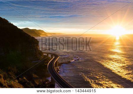 Sea Cliff Bridge Along Australian Pacific Ocean Coast On Sunrise