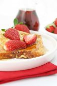 stock photo of french-toast  - French toast with strawberries and maple syrup - JPG