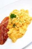 stock photo of scrambled eggs  - Breakfast of creamy scrambled eggs and bacon - JPG