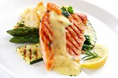 Grilled Atlantic salmon fillet, with roasted vegetables and Bearnaise sauce.