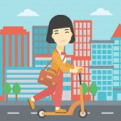 Постер, плакат: An asian young woman riding a kick scooter Business woman with briefcase riding to work on scooter