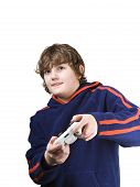 stock photo of video game  - Young boy playing a video game with his tongue out - JPG