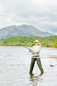 foto of fisherwomen  - fishing woman in Loch Venachar Trossachs Scotland - JPG