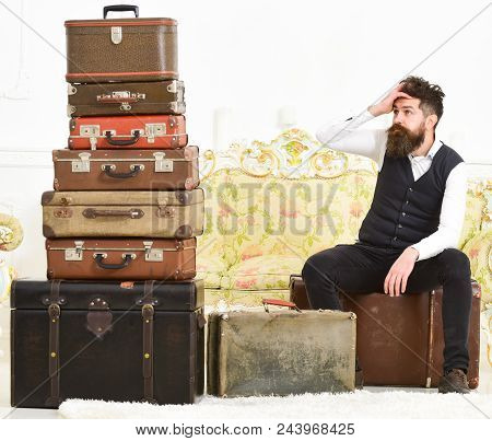 poster of Man With Beard And Mustache Packed Luggage, White Interior Background. Macho Elegant On Tired Face S