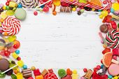 Colorful sweets. Lollipops and candies. Top view with space for your greetings poster
