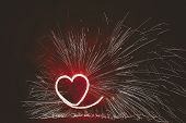 Burning Red Heart With Sparkles, Amazing Fire Show At Night Festival Or Wedding Party. Fire Show Per poster