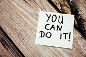 You Can Do It Motivational Handwritten Message On The White Paper With Retro Wooden Bark Background. poster